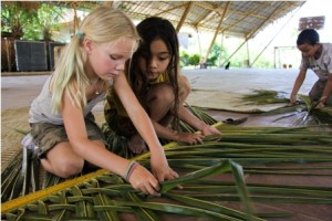 farang kids making bananaleave