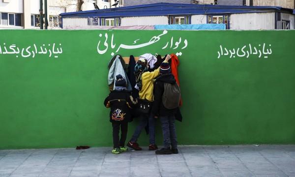Mideast Iran Walls of Kindness