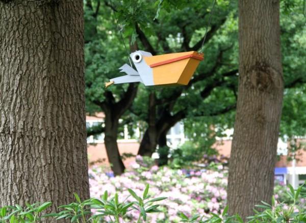 Thomas-Dambo-Scrapwood-Birdhouses-Pelican-Shape-889x649